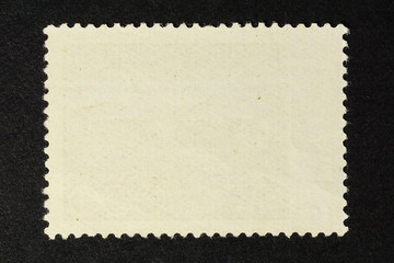 Blank vintage postage stamp on black background. Mockup with perforations for your picture text or design 2.