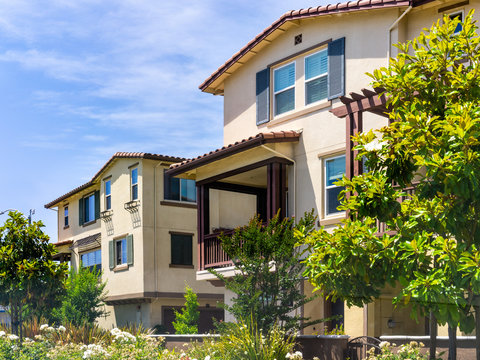 Exterior view of residential building surrounded by trees and hedges; Sunnyvale, San Francisco bay area, California