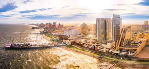 Fototapete - Late afternoon aerial panorama of Atlantic city along the boardwalk. Atlantic City achieved nationwide attention as a gambling resort and currently has nine large casinos.