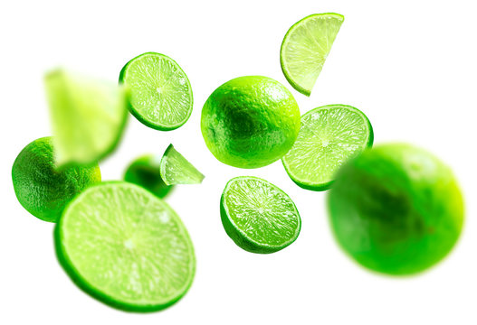 green lime levitated on a white background
