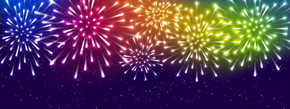 Shiny rainbow fireworks on starry sky background - horizontal panoramic banner for Your holiday design