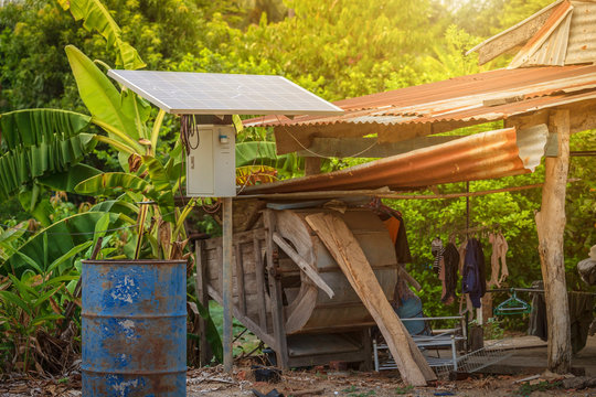 Solar panel in a rural houses area and old oil barrels are ready to recycle Industrial,Agro-industry of household Rural style in Thailand, Alternative energy concept