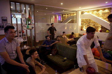 People gather to compete for a bowling match at the Bravo Bowling Alley in Kabul