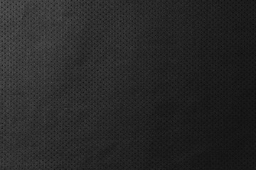 Black jersey texture background. Detail of luxury fabric surface.
