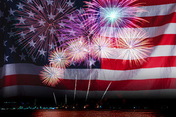 Double exposure of Amazing beautiful colorful fireworks display on celebration night with USA flag, showing on the sea beach with multi color of reflection on water