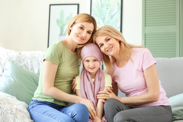 Little girl after chemotherapy with her family at home