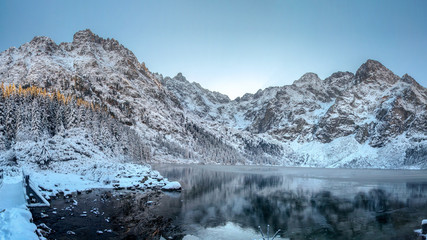 Winter mountains. High Tatra Morskie Oko lake, Poland. Scenic winter landscape of rocky mountain range covered snow