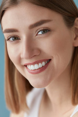 Smiling woman with beauty face and white teeth smile closeup