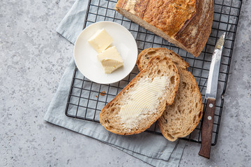 Foto auf Acrylglas Brot slices of freshly baked homemade sour dough bread with butter