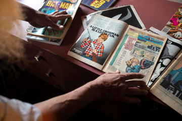 Michael Netzer, an American comics artist formerly named Mike Nasser, shows a comic book page he worked on, at his attic studio in his home in the Jewish settlement of Ofra in the Israeli-occupied West Bank