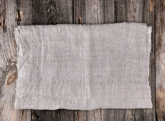 folded gray towel on wooden background