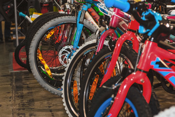 Image of bicycles in the store. Many bicycles and parts in bicycles.