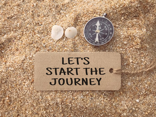 Motivational and inspirational wording - Let's Start The Journey written on a paper tag.
