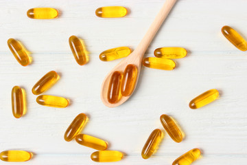 Omega-3 capsules on a colored background. Fish oil, healthy supplements