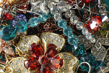 A lot of jewelry for women of different colors and shapes, macro photo of jewelry