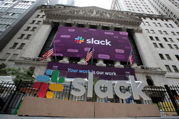 The Slack Technologies Inc. logo is seen on a banner outside the New York Stock Exchange (NYSE) during the company's direct listing in New York