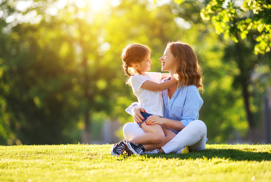 happy family mother and child daughter in nature   in summer