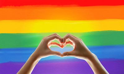Rainbow flag, hand showing heart symbol