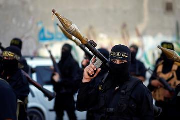Palestinian Islamic Jihad militants take part in an anti-Israel military show at Al-Shati refugee camp in Gaza City