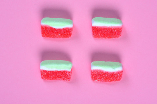group of watermelon candy on pink background