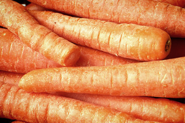 Vegetable background: bunch of fresh carrots, healthy ingredients in the kitchen