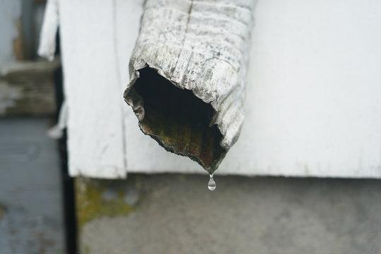 gutter water leak dirty