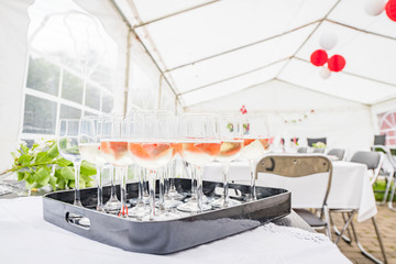 Drinks on a table in a bright tent at a party