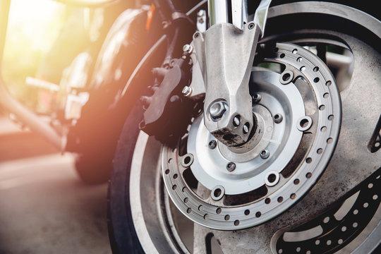 Closeup detail of steering wheel of motorcycle, perforated brake disc