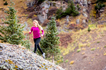 Gold King Basin, near Telluride, Colorado, USA: A female runner running the alpine trails at the Gold King Basin.