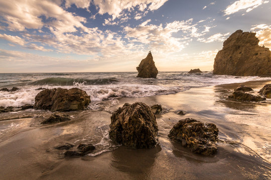 Beach, Malibu, California, USA: Famous El Matador Beach during sunset in summer.
