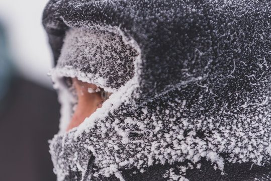 Close up of man with frozen clothes in very cold weather