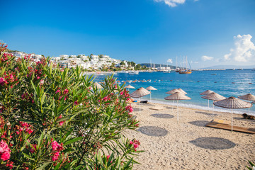 View of Bodrum Beach, Aegean sea, traditional white houses, marina, sailing boats, yachts in Bodrum town Turkey.