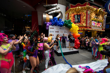 Drag Queens celebrate after setting a Guinness World Record for the longest feather boa at 1.2 miles, along 42 St, in Times Square in New York