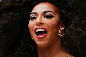 Drag Queen Shangela attends event to set a Guinness World Record for the longest feather boa at 1.2 miles, along 42 St, in Times Square in New York