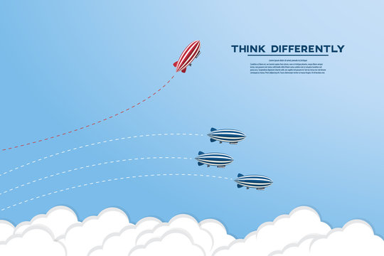Think differently concept. Be different. Red zeppelin changing direction. New idea, change, trend, courage, creative solution, innovation and unique way concept.