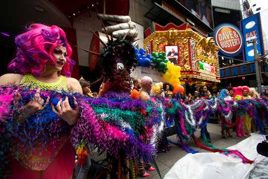 Drag Queens help to set a Guinness World Record for the longest feather boa at 1.2 miles, along 42 St, in Times Square in New York