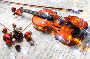 Close-up Photo Of Violin, Musical Notes and Christmas decoration