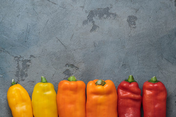 Ripe Colorful Ramiro Peppers on stone background, copy space