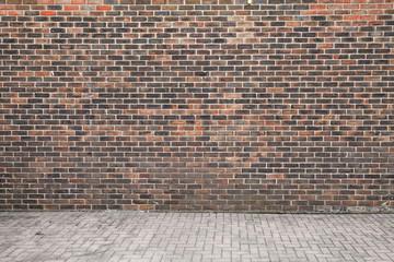 Wall Mural - Dark brick wall and cobblestone floor