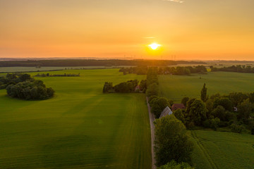 sunset over an agricultural field or meadow, sunset sky