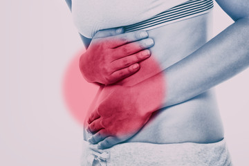 Stomach pain woman with red circle targeting painful area on lower abdomen body. Medical issue of gut health or crohn's disease, ibs syndrome and more.