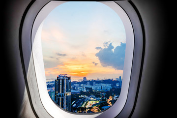 Beautiful sunset city view of singapore from plane window