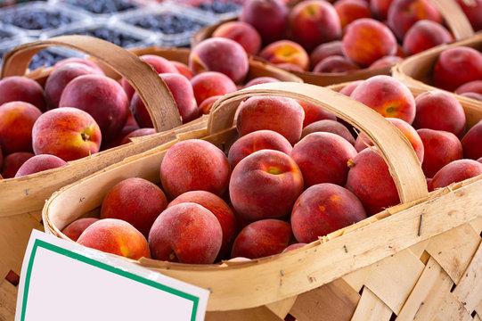 Baskets of fresh yellow peaches