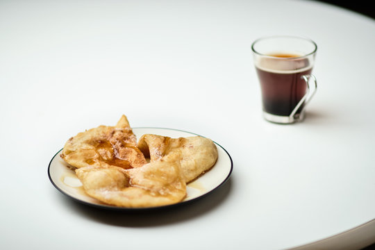 Sopapilla desserts with a cup of coffee