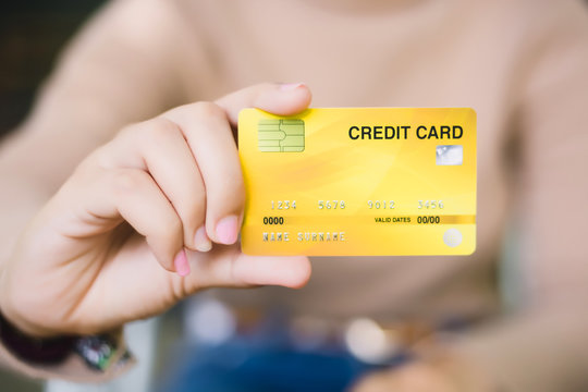 Young female holding credit card, Online shopping or paying concept.