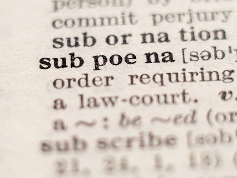 Dictionary definition of word subpoena, selective focus.
