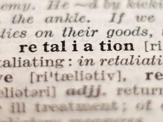 Dictionary definition of word retaliation, selective focus.