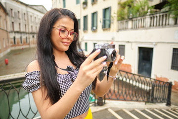 Smiling woman Tourist Takes Photos In Italy