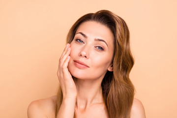 Obraz Close up photo beautiful amazing mature she her lady overjoyed after salon spa procedures aesthetic pretty ideal appearance nude arm hand palm touch cheek perfection isolated pastel beige background - fototapety do salonu