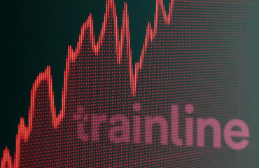 Trainline logo is reflected on a displayed stock graph in this picture illustration